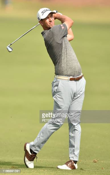 Australian golfer Adam Scott hits a shot on the fairway at the 1st hole on day two of the Australian Open golf tournament at the Australian Golf Club...