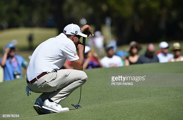 Australian golfer Adam Scott lines up a putt on the second hole on day two of the Australian Open golf tournament at the Royal Sydney Golf Club in...