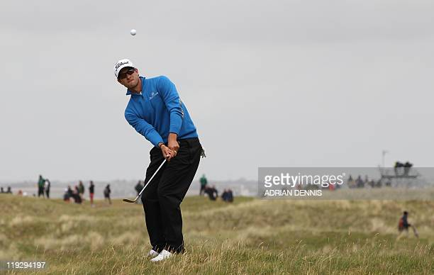 Australian golfer Adam Scott plays a shot on the 3rd fairway on the final day of the 140th British Open Golf championship at Royal St George's in...