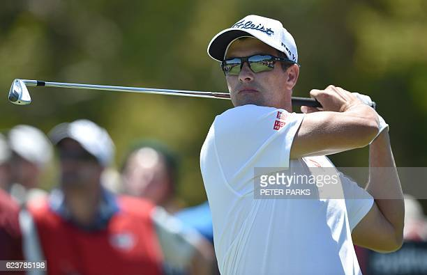 Australian golfer Adam Scott tees off at the 4th hole during day one of the Australian Open golf tournament at the Royal Sydney Golf Club in Sydney...