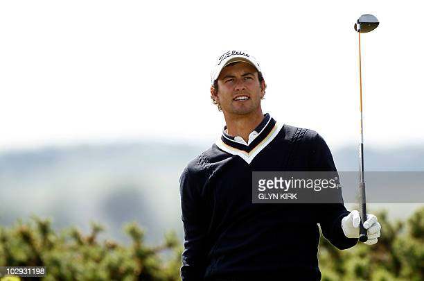Australian golfer Adam Scott watches his drive from the 10th tee during his second round on day two of the British Open Golf Championship at St...