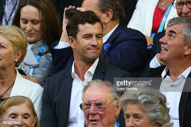 Australian golfer Adam Scott watches the action at Rod Laver Arena during day 14 of the 2015 Australian Open at Melbourne Park on February 1 2015 in...
