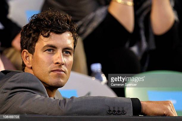 Australian golfer Adam Scott watches the semifinal match between Andy Murray of Great Britain and David Ferrer of Spain during day twelve of the 2011...