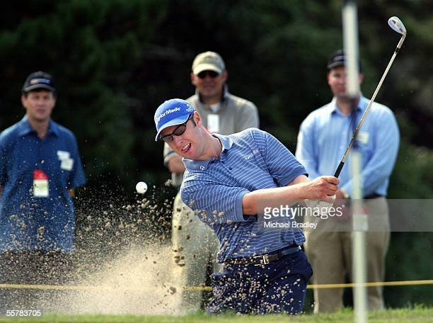 Australian golfer Brendan Jones tees chips out of the bunker during the second round of the Holden New Zealand Open being played at the Auckland Golf...