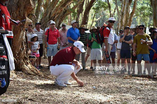 Australian golfer Cameron Smith checks his ball in the rough on the eighteenth hole at the Australian Open golf tournament at the Royal Sydney Golf...