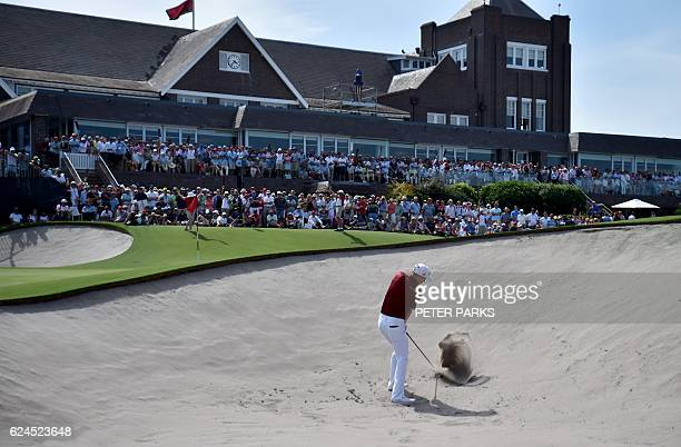 Australian golfer Cameron Smith hits a shot out of the bunker on the eighteenth hole at the Australian Open golf tournament at the Royal Sydney Golf...