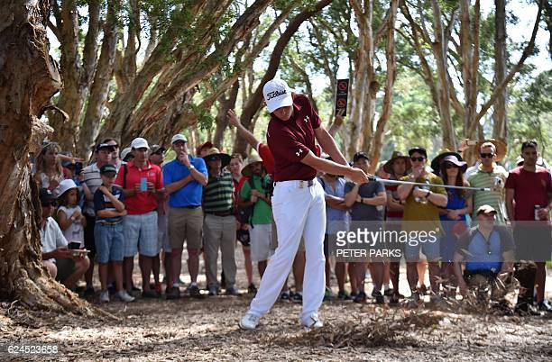 TOPSHOT Australian golfer Cameron Smith hits a shot out of the rough on the eighteenth hole at the Australian Open golf tournament at the Royal...