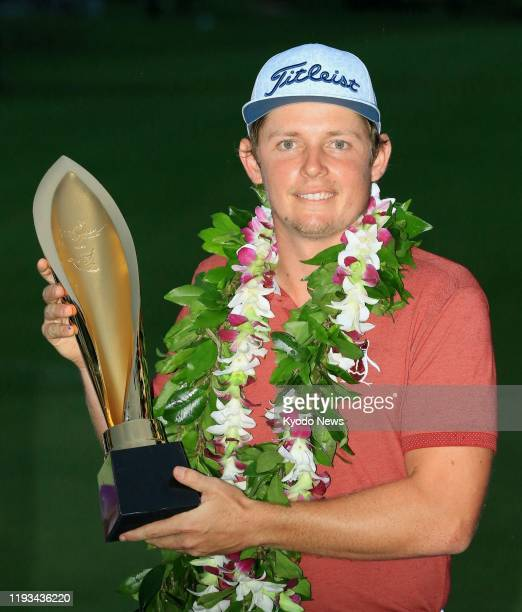 Australian golfer Cameron Smith holds the trophy after winning the Sony Open in Hawaii on Jan 12 at Waialae Country Club in Honolulu