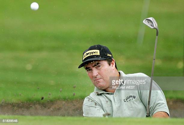 Australian golfer Craig Parry chips out of a bunker and into the hole for a birdie on the 16th during the first round of the Australian Masters at...