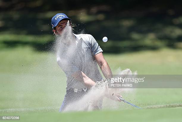 TOPSHOT Australian golfer Curtis Luck hits his ball out of the bunker on day two of the Australian Open golf tournament at the Royal Sydney Golf Club...