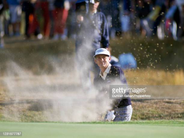 Australian golfer David Graham hitting the ball out of a bunker during The British Open Golf Championship at Royal St George's Golf Club in Sandwich,...