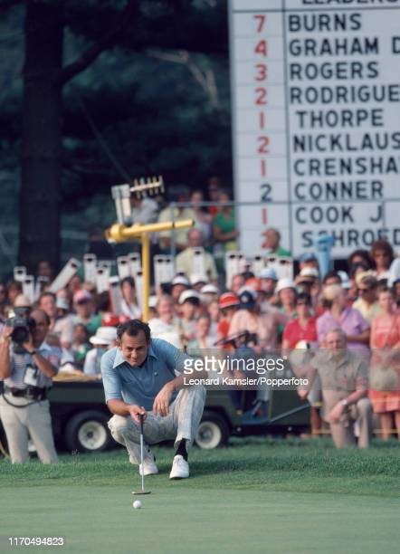 Australian golfer David Graham lines up a putt enroute to winning the US Open Golf Championship held on the East Course of Merion Golf Club in...