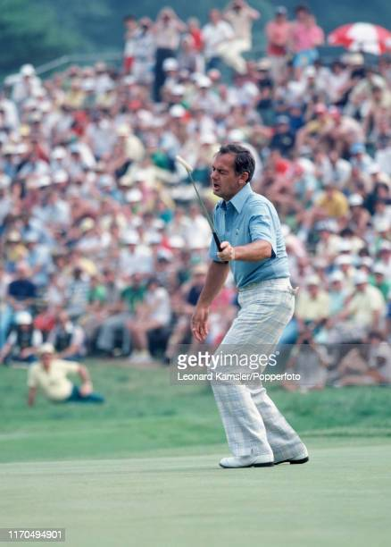 Australian golfer David Graham sinks his putt to win the US Open Golf Championship held on the East Course of Merion Golf Club in Ardmore,...