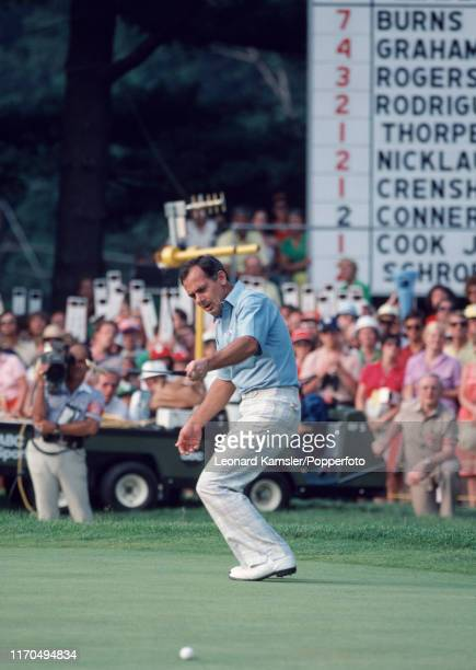 Australian golfer David Graham tracks his putt enroute to winning the US Open Golf Championship held on the East Course of Merion Golf Club in...