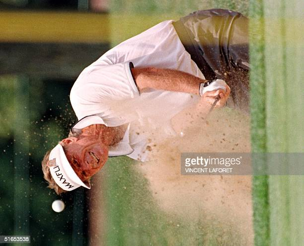Australian Golfer Graham Marsh shoots out of a trap on the third hole for par 29 June at the1997 US Senior Open golf Championship at Olympia Fields...