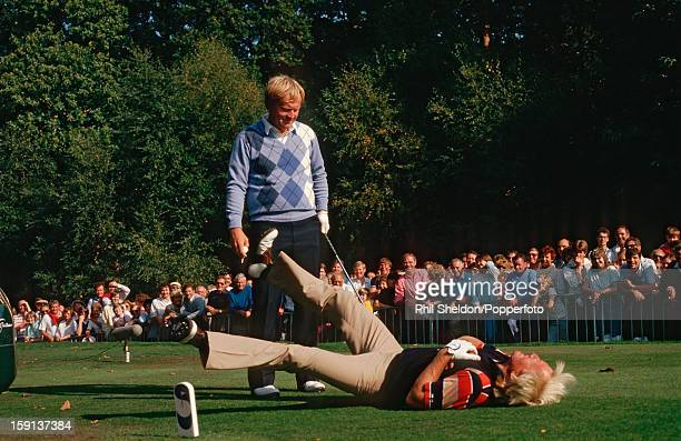 Australian golfer Greg Norman feigns a heart attack on the 15th tee during his round with Jack Nicklaus of the United States at the Suntory World...