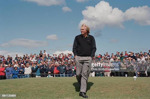 Australian golfer Greg Norman pictured walking off a tee during play to finish in joint 15th place at the 1995 Open Championship on the Old Course at...