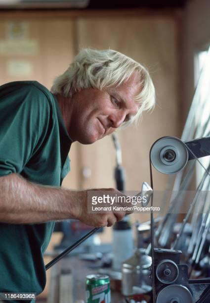 Australian golfer Greg Norman working on a golf club in his workshop circa 1987