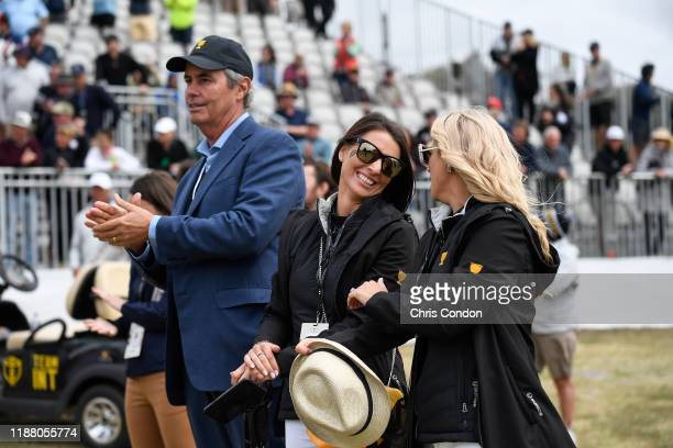 Australian golfer Ian Baker Finch NelMare Ooosthuizen and Carminita Immelman watch play during the first round fourball matches of the Presidents Cup...