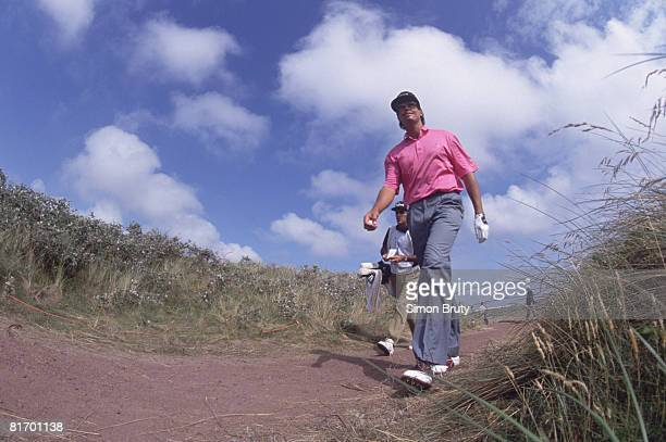 Australian golfer Ian BakerFinch walks to the 18th tee before winning the British Open Championship at the Royal Birkdale golf course 1991