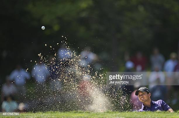 Australian golfer Jason Day hits from a bunker during the first round of the Quicken Loans National at Congressional Country Club in Bethesda...