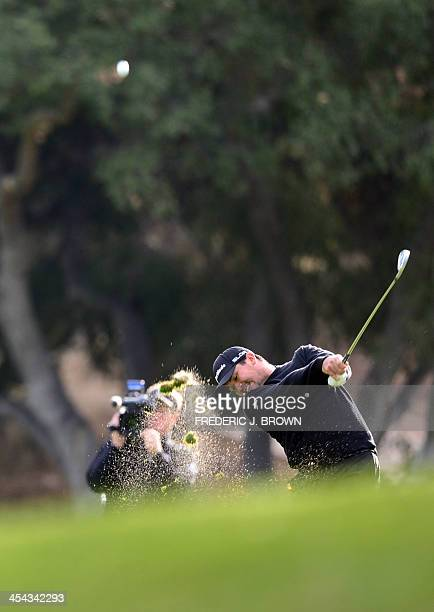 Australian golfer Jason Day plays a shot to the green at the 18th hole during the final round of play at the Northwestern Mutual World Challenge golf...