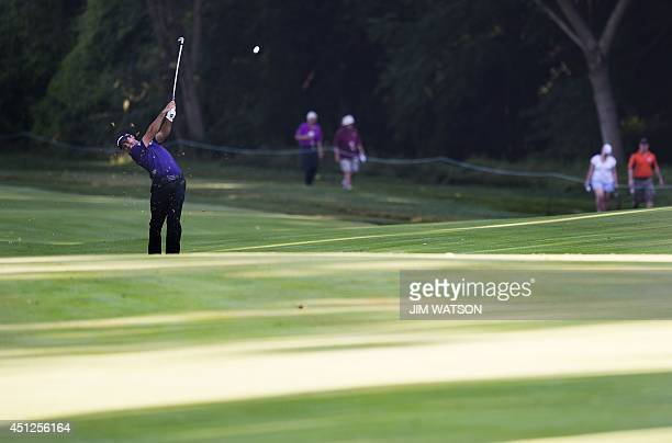 Australian golfer Jason Day swings from the fairway during the first round of the Quicken Loans National at Congressional Country Club in Bethesda...