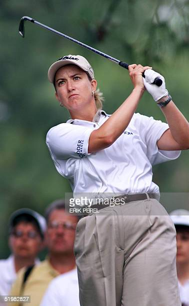 Australian Golfer Karrie Webb watches her tee shot on the 13th hole 1 June 2001 during the second round of the US Women's Open at Pine Needles Lodge...