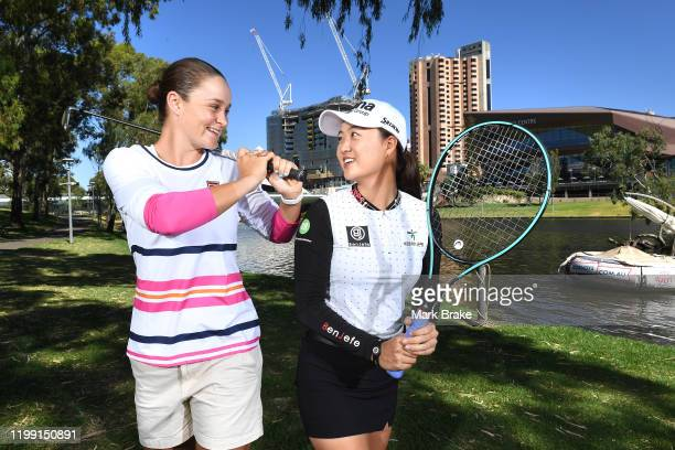 Australian golfer Minjee Lee and World womens number one tennis player Ash Barty of Australia pose on Pinky Flat on the River Torrens during day two...