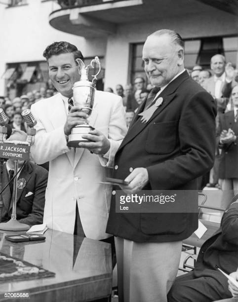 Australian golfer Peter Thomson receives the Open Golf Championship cup from S T L Greer Captain of the Royal Birkdale Golf Club at Southport 10th...