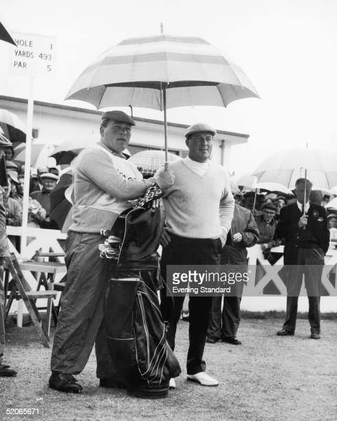Australian golfer Peter Thomson shares an umbrella with his favourite caddy during the British Open at Southport July 1965 He went on to win the...
