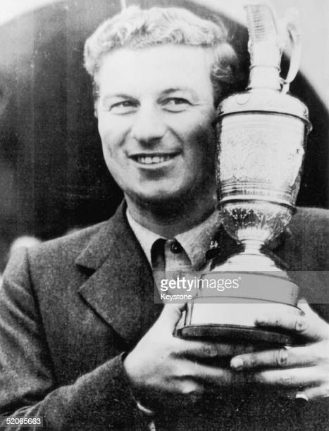Australian golfer Peter Thomson with his trophy after winning the Open Championship at Hoylake for the third year in succession 7th July 1956 He is...