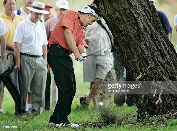 Australian golfer Stuart Appleby hits a ball lefthanded into a tree and out to a bunker during the second round of the Australian Masters being...
