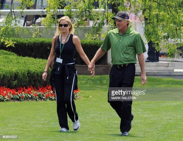 Australian golfing legend Greg Norman with his fiance American tennis great Chris Evert before he tees off at the BMW Asian Open golf championship in...