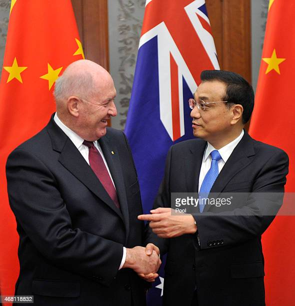 Australian Governor General Peter Cosgrove shakes hands with Chinese Premier Li Keqiang before a meeting at the Great Hall of the People on March 30,...