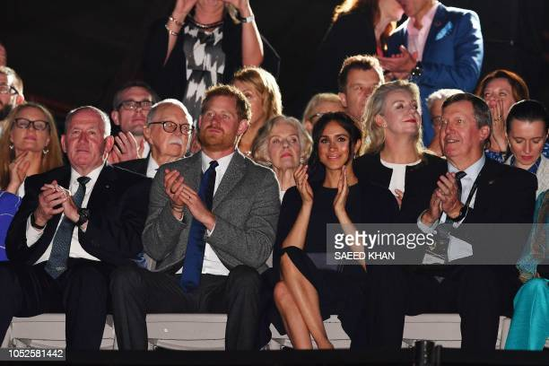 Australian GovernorGeneral Peter Cosgrove Britain's Prince Harry and his wife Meghan applaud during the opening ceremony of the Invictus Games in...
