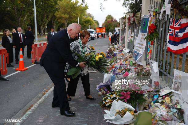 Australian GovernorGeneral Sir Peter Cosgrove and his wife Lynne Lady Cosgrove pay tribute outside the AlNoor Mosque on March 29 2019 in Christchurch...