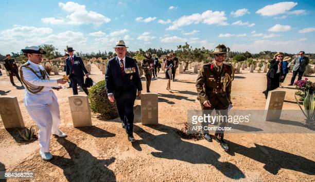 Australian Governorgeneral Sir Peter Cosgrove attends a ceremony at El Alamein War Cemetary marking 75 years since the pivotal WWII battle in the...