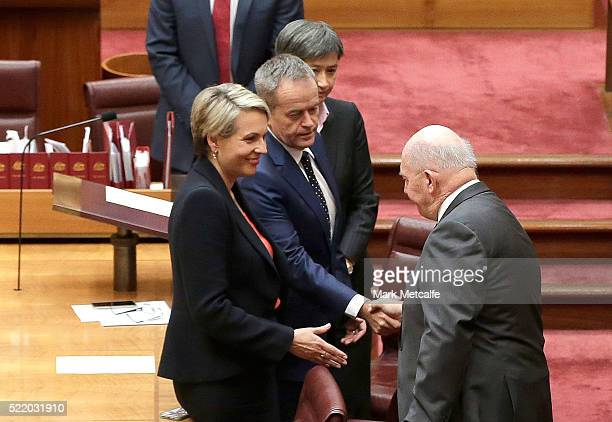 Australian GovernorGeneral Sir Peter Cosgrove shakes hands with Leader of the Opposition Bill Shorten as Deputy Leader of the Opposition Tanya...
