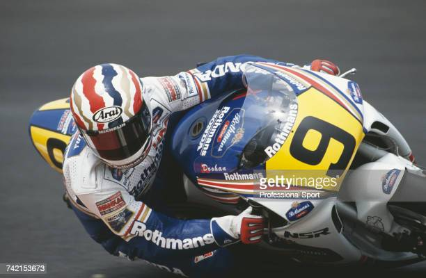 Australian Grand Prix motorcycle road racer Mick Doohan rides the 500cc Honda to finish in 3rd place in the 1990 Nations motorcycle Grand Prix at the...