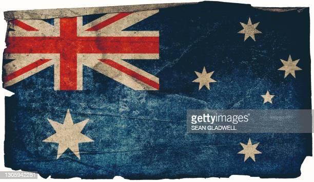 australian grunge flag poster - australian flag stock pictures, royalty-free photos & images