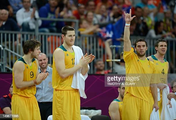 Australian guard Matt Dellavedova , Australian centre Aron Baynes and Australian guard Adam Gibson celebrate at the end of the men's preliminary...