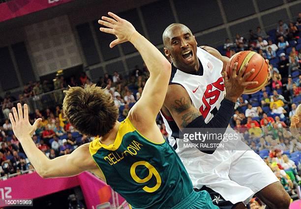 Australian guard Matt Dellavedova challenges US guard Kobe Bryant during their London 2012 Olympic Games men's quarterfinal basketball match in...