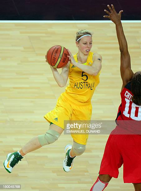 Australian guard Samantha Richards is challenged by US forward Tamika Catchings during the London 2012 Olympic Games women's semifinal basketball...