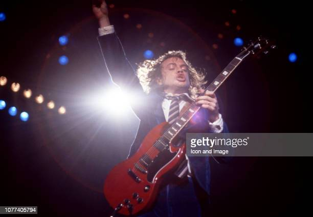 Australian guitarist Angus Young of AC/DC plays in his schoolboyuniform during the Flick of the Switch Tour on November 17 1983 at Joe Louis Arena in...