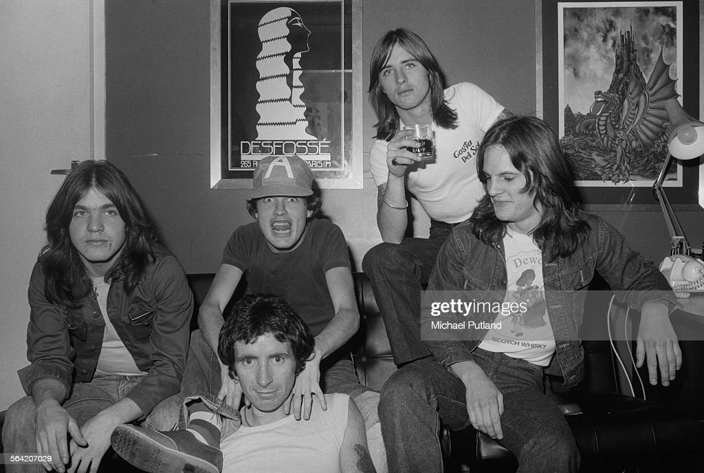 Australian hard rock group AC/DC, London, 8th April 1976. Left to right: rhythm guitarist Malcolm Young, singer Bon Scott (1946 - 1980, front), lead guitarist Angus Young, drummer Phil Rudd and bassist Mark Evans.
