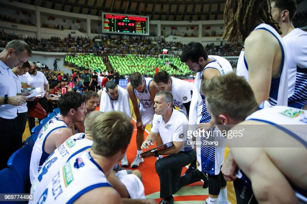 Australian head coach Andrej Marcus Lemanis addresses his players during the 2018 SinoAustralian Men's Internationl Basketball Challenge match...