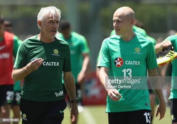 Australian head coach Bert van Marwijk and Aaron Mooy of Australia walk off the Australian Socceroos Training Session at the Gloria Football Club on...