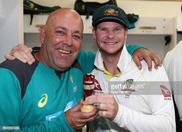 Australian Head Coach Darren Lehmann and Steve Smith of Australia celebrate in the changerooms after Australia regained the Ashes during day five of...
