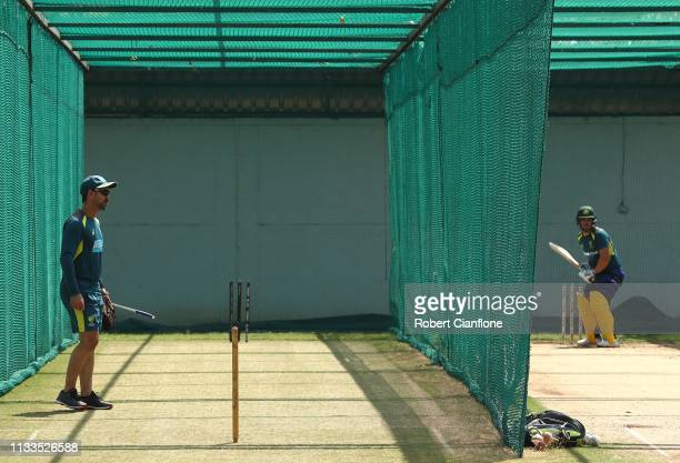 Australian Head Coach Justin Langer watches Aaron Finch of Australia in the nets ahead of game two of the One Day International series between India...